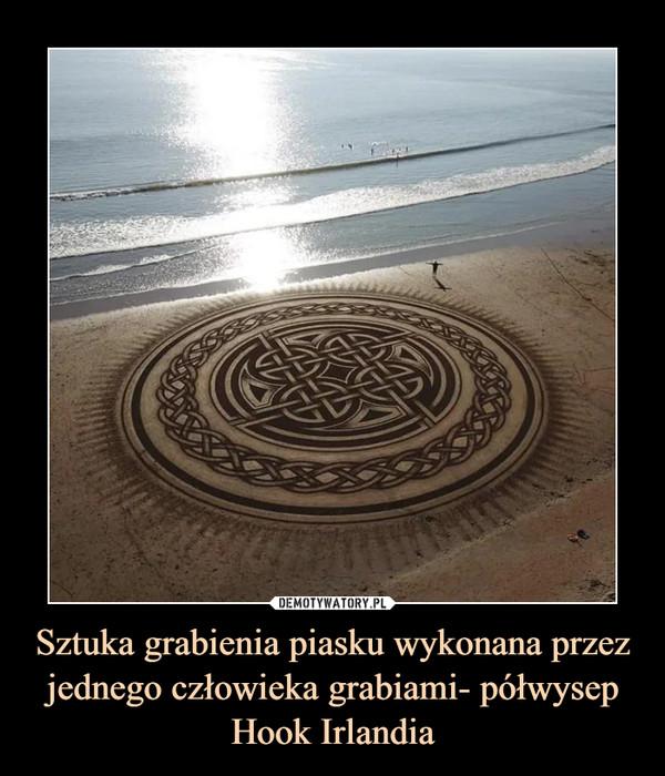 Sztuka grabienia piasku wykonana przez jednego człowieka grabiami- półwysep Hook Irlandia –